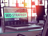 SEO Strategy Concept on Laptop Screen.