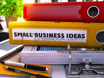 Small Business Ideas on Yellow Office Folder. Toned Image.
