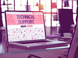 Technical Support on Laptop in Modern Workplace Background.