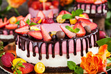 Delicious double cheesecake decorated with chocolate and fresh s