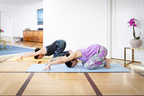 two women doing yoga at home Balasana variation