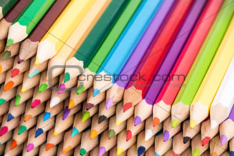 Close up of color pencils pile front facing