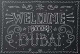 Welcome to Dubai. Hand drawn vintage lettering on black chalkboa