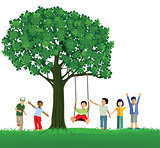 Children swinging on a tree