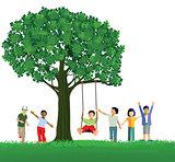Children swinging on a tree