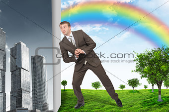 Businessman changing city on nature landscape