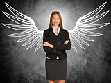 Businesswoman with drawn angel wings