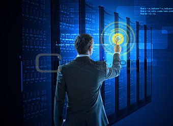 Business man using circle interface in data center