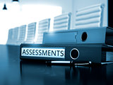 Assessments on Office Binder. Blurred Image.