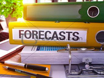 Forecasts on Yellow Office Folder. Toned Image.
