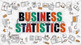 Business Statistics on White Brick Wall.