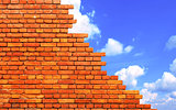 Damaged brick wall and blue sky