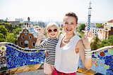 Smiling mother and baby at Park Guell handwaving, Barcelona