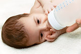 Newborn baby eating from the plastic bottle