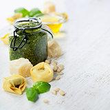 Homemade raw Italian tortellini with pesto