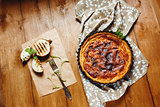 Pie or Tart Served with Grilled Halves of Onion