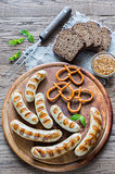 Grilled sausages with pretzels