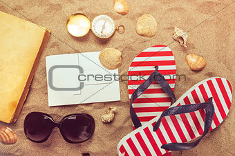 Beach ready, summer holiday vacation accessories on sandy beach
