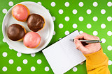 Writing recipe for homemade delicious donuts with sweet topping