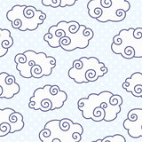 Seamless pattern with funny clouds on dotted light blue background.
