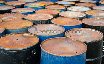 Tops of many rusted storage drums.