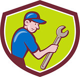 Handyman Holding Spanner Crest Cartoon