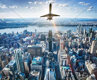 airplane over a skyline
