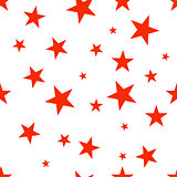 Seamless pattern with red stars.