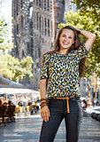 Portrait of smiling woman staying on street near Sagrada Familia