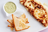Omelette with toastes and green sauce