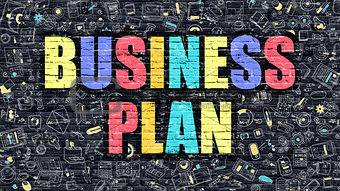 Business Plan on Dark Brick Wall.