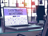 Data Traffic Monitoring on Laptop in Modern Workplace Background.