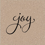 Hand lettered vector word Joy on a beige salt and pepper textured background.