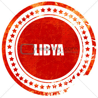 Greetings from libya, grunge red rubber stamp on a solid white b