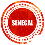 Greetings from senegal, grunge red rubber stamp on a solid white