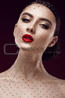 Portrait of beautiful girl with bright makeup and crystals on the body. beauty face.