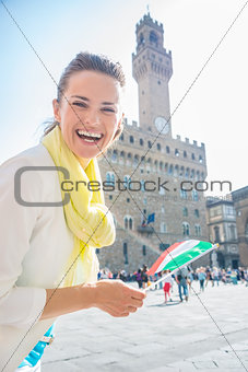 Portrait of smiling woman with Italian flag near Palazzo Vecchio