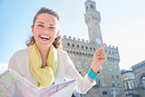 Woman with map near Palazzo Vecchio pointing on something