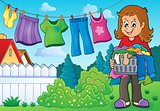 Woman with laundry outdoor