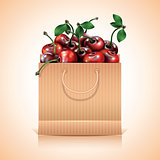 Many cherries in the paper bag.