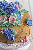 Festive cake with flowers of cream closeup.