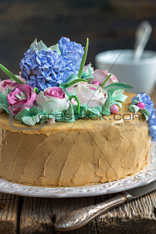Cake with cream flowers from close up.