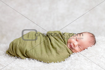 Beautiful newborn wrapped in a blanket