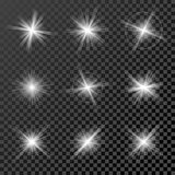 Set of glowing lights, stars and sparkles isolated on black  transparent background