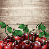 Many cherries on wooden texture background.
