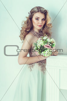 Beautiful bride in wedding dress. Portrait of young bride. Studio shot.