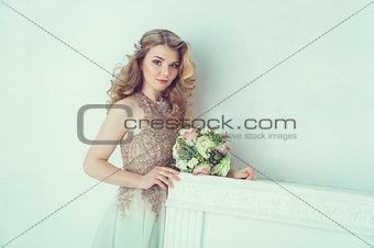 Beautiful bride in wedding dress. Portrait of young bride. Studio shot.