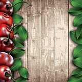 Many cherries and leaves on wooden background.