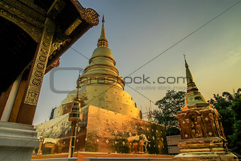 Chapel of Thai temple handmade and Golden Pagoda at Wat Pra Singh, Chaingmai, Thailand