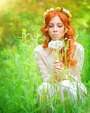 Pretty woman with dandelion flowers